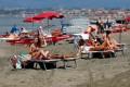 People sunbathe at the beach in Fregene, Italy. Photo: Reuters