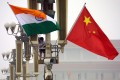 Indian and Chinese flags are seen in Beijing. Troops along the shared border have been locked in a tense stand-off for nearly a month, with India's defence minister Rajnath Singh on Sunday admitting to tensions. Photo: AFP