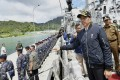Indonesian President Joko Widodo, second right, pictured in January on the deck of an Indonesian Navy ship in the Natuna Islands, which overlap with Beijing's expansive South China Sea claims. Photo: A