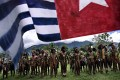 Central Highlands villagers, shown here with the Morning Star flag in the West Papua capital, have been fighting to recover their ancestral lands for 50 years. Picture: Getty Images