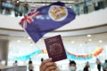 A protester holds a BN(O) passport during an anti-government demonstration at a Hong Kong shopping centre in May. Photo: Winson Wong