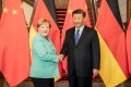 German Chancellor Angela Merkel shakes hands with Chinese President Xi Jinping during their meeting in Beijing in September last year. Photo: DPA