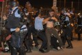 New Orleans police clash with protesters during demonstrations over the death of George Floyd. Photo: AP