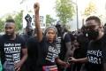 Assa Traore, sister of Adama Traore, raises her fist during a protest in Paris. Photo: AP