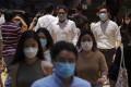 Hong Kong residents were quick to adopt the wearing of masks. Photo: Sam Tsang