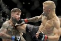 TJ Dillashaw kicks Cody Garbrandt at their UFC title bantamweight title fight at UFC 227 in Los Angeles in 2018. Photo: AP