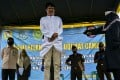 A man receives 100 whippings by religious police in Jantho, Aceh province. Photo: AFP