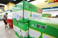 Boxes of Mengniu's milk products are seen at a supermarket in Beijing. Photo: Reuters