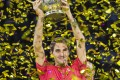 Switzerland's Roger Federer holds the trophy aloft after winning his tenth title at the 2019 Swiss Indoors tennis tournament in Basel, Switzerland. Photo: AP