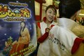 Chinese models at the launch of the NetEase online gaming package aimed at young women on 12 January 2004. Photo: Mark Ralston
