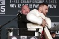 Conor McGregor is restrained by UFC president Dana White during a press conference before his fight against Eddie Alvarez at UFC 205 in Madison Square Garden, New York in 2016. Photo: AP