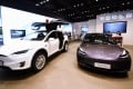 Tesla's Model X electric sport utility vehicle with double-hinged gull wing doors, left, and its Model 3 car are seen on display at the company's store in Hangzhou, capital of eastern China's Zhejiang province, on April 21. Photo: Longwei/SIPA Asia via ZUMA Wire