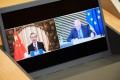 Chinese Foreign Minister Wang Yi (left) and Josep Borrell, the EU high representative for foreign affairs, on a screen during a videoconference meeting of the EU-China Strategic Dialogue on Tuesday. Photo: Dati Bendo/European Commission via dpa