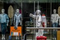 A worker disinfects a shopping mall during the coronavirus pandemic, in Medellin, Colombia. The fashion industry is looking into the many ways it can fight the spread of viruses and bacteria in its clothing. Photo: AFP