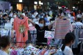 A vendor displays clothing items for sale at a street stall in Wuhan. Photo: Reuters