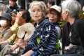 Elderly residents rest in the grounds of a temple in Tokyo. Japan suffers from a shortage of carers and an ageing population. The solution the country's come up with: wearables, sensors and data that can help people look after their older clients remotely. Photo: AFP