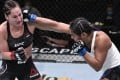 UFC women's flyweight contender Cynthia Calvillo punches number one ranked Jessica Eye in their flyweight fight during UFC Fight Night at the UFC Apex in Las Vegas, Nevada. Photo: USA Today