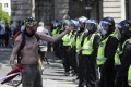 A far-right protester gestures towards police officers at Trafalgar Square in London. Photo: AP