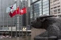 A bronze sculpture of a bull looks over Exchange Square, home to many financial companies and the Hong Kong stock exchange, in the city's Central business district. Photo: Warton Li