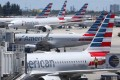Local officials are considering two bids to build 12 jet bridges at Miami International Airport. Photo: AP