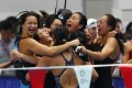 Hong Kong women's medley relay team celebrate after capturing a silver medal at the 2018 Asian Games in Jakarta. Photo: Reuters