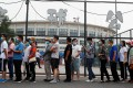 Beijing residents queue outside a sports centre for a Covid-19 nucleic acid test. Photo: Reuters