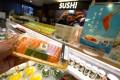 Salmon sashimi and sushi sets are still a popular choice at a supermarket in Causeway Bay. Photo: Felix Wong
