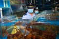 A seafood stall is inspected at a Beijing wholesale food market. Photo: Xinhua