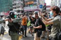 A police officer points pepper spray at a member of the press in Mong Kok on May 1. Photo: Sam Tsang