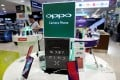 Oppo smartphones are displayed in a shop in Singapore. Photo: Reuters