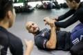 Head coach Siyar Bahadurzada teaches his students how to defend in bottom guard position. Photo: Evolve MMA