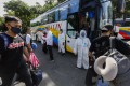 Filipinos stranded due to quarantine protocols prepare to board a bus for travel to their home province of Isabela from Quezon City, Metro Manila. Photo: EPA