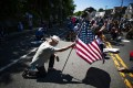 Demonstrators kneel during a solidarity protest for George Floyd on June 13 in West Point, New York. Photo: AP