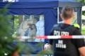 Police officers investigate a crime scene where a man was shot in the head in the Kleiner Tiergarten in Moabit, Berlin. Photo: EPA-EFE