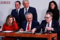 Jesus Seade (front, centre) helped negotiate the United States-Mexico-Canada Agreement (USMCA) with US Trade Representative Robert Lighthizer (front, right). Photo: Reuters