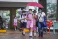 Primary school students walk to school in Sha Tin as classes resume on June 8. Children should be involved in the consultation process on issues that affect them at an earlier stage. Photo: Winson Wong