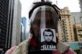 """A man wears a protective face shield with a sticker of the image of Brazil's President Jair Bolsonaro reading """"not him"""" during a protest against racism and fascism in Sao Paulo. Photo: Reuters"""