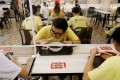 Singaporeans eat at a food court after the city state eased coronavirus restrictions. Photo: Reuters