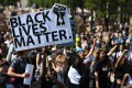 Activists attend a Black Lives Matter march in Hyde Park in central London on June 20. Protests were being held in major cities across Britain. Photo: AFP