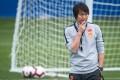 China head coach Li Ti takes a training session. Photo: Xinhua