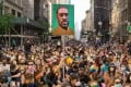 Protesters march down Fifth Avenue in New York demanding police reform on June 10. Held aloft is a picture of George Floyd, a 46-year-old African-American who died during a police arrest in Minnesota two weeks before. Photo: AFP