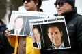 People hold signs calling for China to release Canadian detainees Michael Spavor and Michael Kovrig at a demonstration held in March. Photo: Reuters