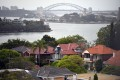 Luxury houses in Sydney. A recent diplomatic spat between Australia and China is stoking concerns among analysts about the impact on its real estate and education sectors. Photo: EPA-EFE