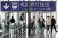 Travellers arrive at Taipei's Taoyuan airport in March, before foreign travellers and international flight transfers were suspended. Photo: Reuters