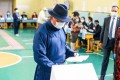 Mongolia's Prime Minister Ukhnaagiin Khurelsukh wears a face mask as he votes at a polling site in Ulan Bator on Wednesday. Photo: AFP