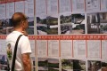 A pedestrian looking at some distressed assets for auction in Hong Kong. Photo: K.Y. Cheng