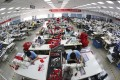 Workers making down jackets at a Bosideng factory in Changshu city in eastern Jiangsu province. Photo: Imaginechina