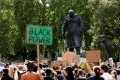 Black Lives Matter protesters gather around the statue of Winston Churchill following a march through central London, in Britain, on June 21. Photo: Getty Images