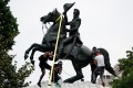 Protesters attempt to pull down the statue of former US president Andrew Jackson in the middle of Lafayette Park in front of the White House during racial inequality protests in Washington on June 22. Photo: Reuters