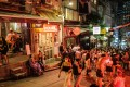 """People visit bars and restaurants in Peel Street, Central, Hong Kong. Some local Chinese people don't like to eat out in Central and Mid-Levels because they think there are too many """"gweilos"""" (a pejorative Chinese term for white people), Andrew Sun writes. Photo: AFP"""